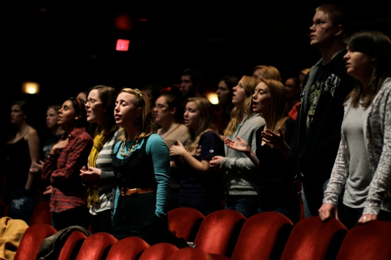 Students worshipping during large group last year