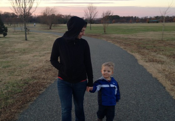 Mommy and Julian taking a walk at the park.