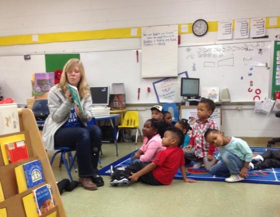 CNU IV junior Sarah Martin reading to the kids at CHAT.